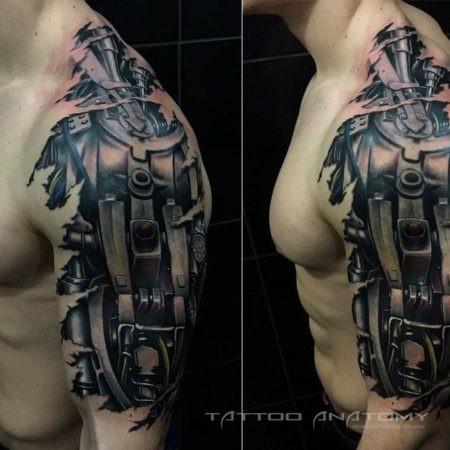 Мужское тату в стиле биомеханика на плече