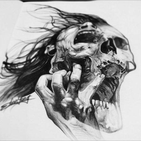 эскиз тату стиля Black gray череп в руке