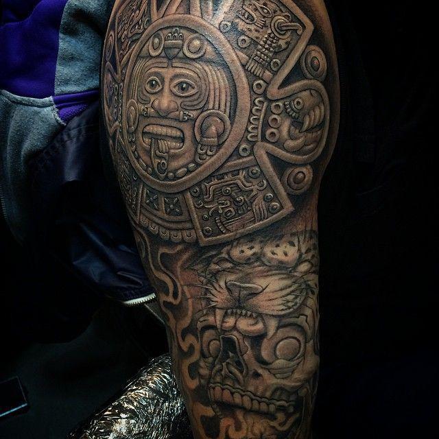 Мужское тату в стиле майя на плече