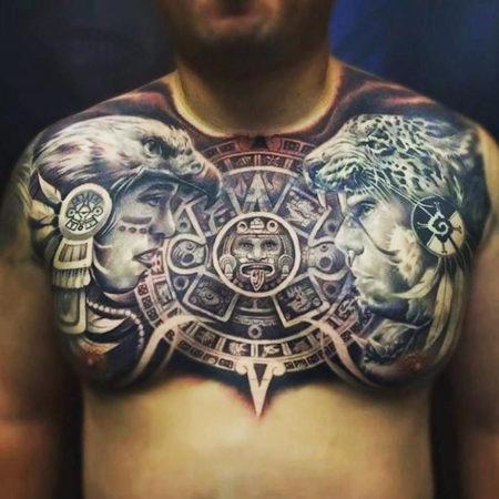 Мужское тату в стиле майя на груди