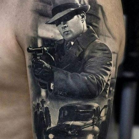 Тату в стиле Black gray на руке машина военные