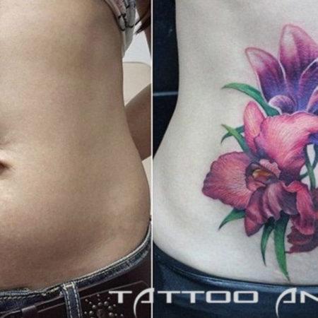 Татуировка на шраме цветочки