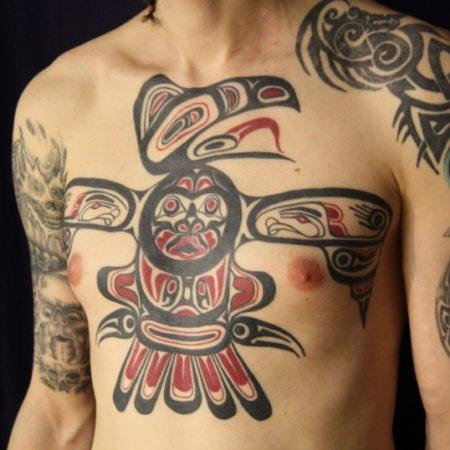 Мужское тату в стиле хайда на груди