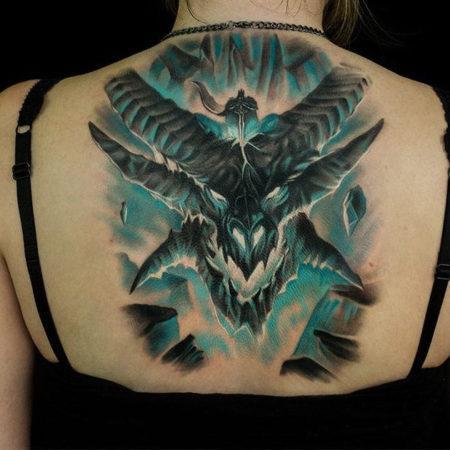 Женское тату в стиле фентези на спине