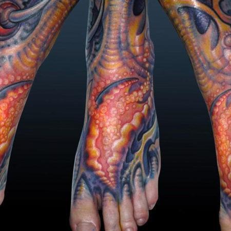 Мужское тату в стиле органика на стопе