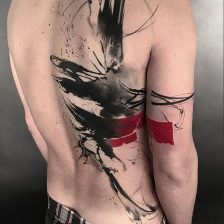 Мужское тату в стиле треш полька на спине