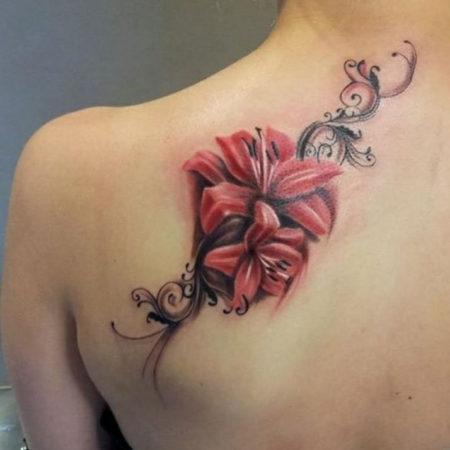 Женское тату на лопатке цветы в стиле готика