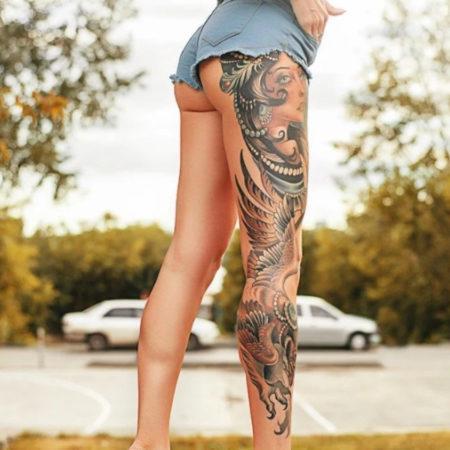 Женское тату на ноге в стиле восточные мотивы