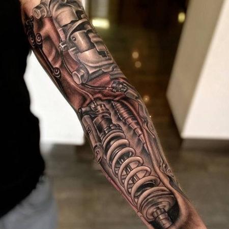 Мужское тату в стиле биомеханика рукав