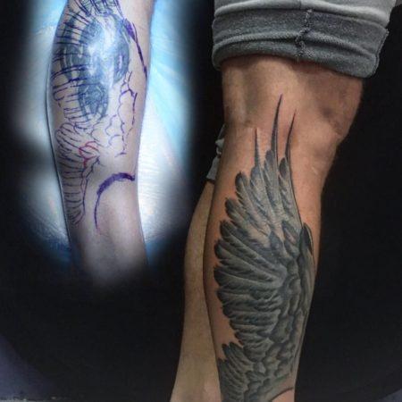 Перекрытие татуировки на голени - крыло
